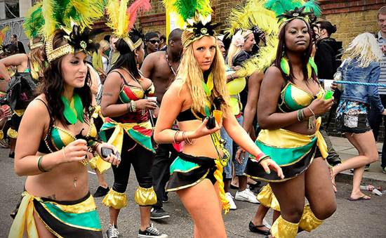 Girls in Colorful Costumes at the Notting Hill Carnival in London