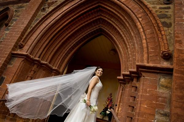 A Bride in front of a Chapel Door
